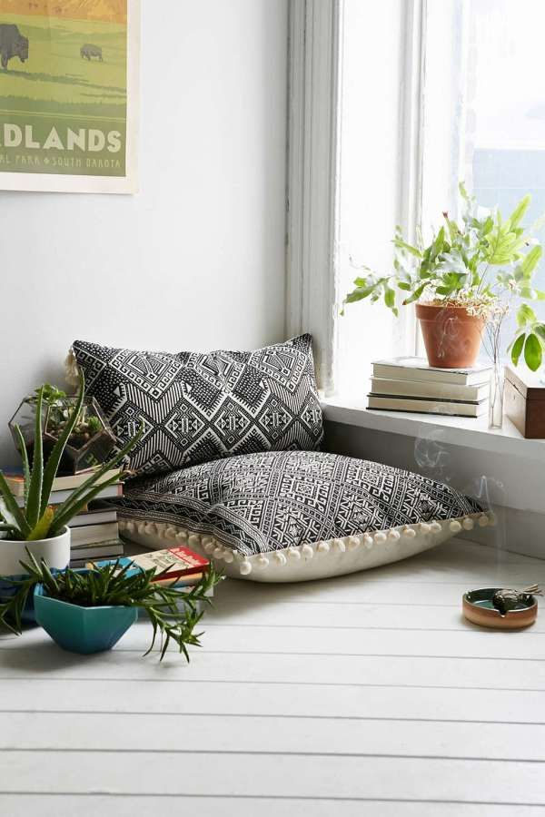 Pillows and decor to create a zen meditation space for the home.