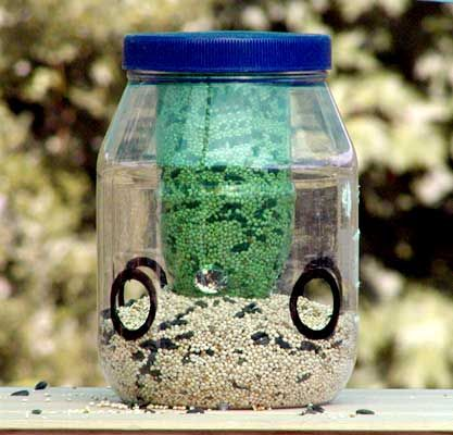 14 best images about recycled bird squirrel feeders on for Plastic bottle bird house