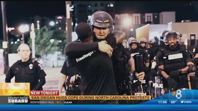 Chula Vista man hugs police during North Carolina protests - CBS News 8 - San Diego, CA News Station ...