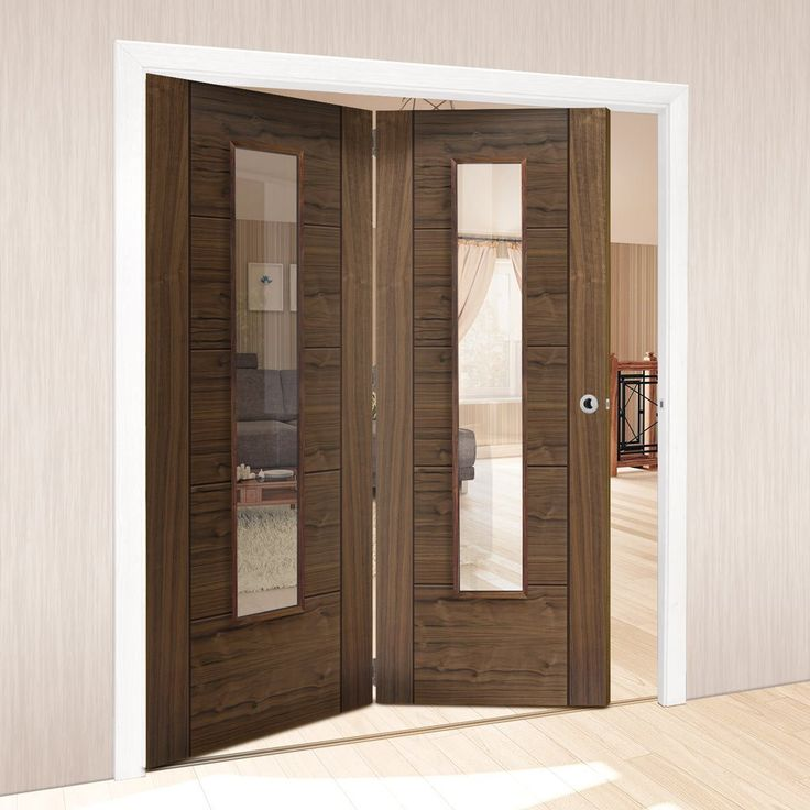 Thrufold Emral Walnut 2+0 Folding Door With Clear Safety Glass - Pre-finished.    #walnutdoors #glazeddoors #doors #foldingdoors #thrufold #bifold #roomfold #interiordoors #roomdividers