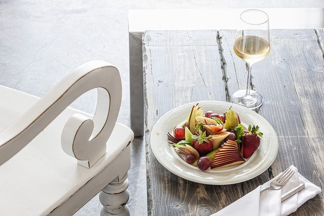 A glass of a fine #Santorinian wine and a plate of fresh fruits. Amazing! #AndronisExclusive #Santorini