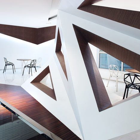 Triangular windows pierce the faceted walls that fold around a cafe in Hangzhou, China.