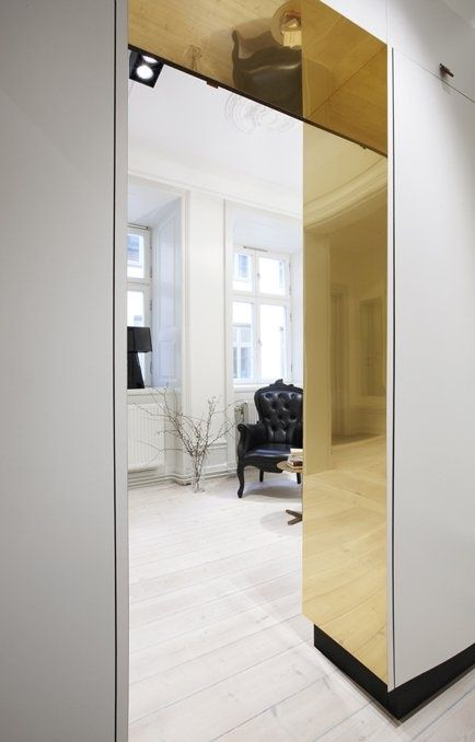 Gold clad architrave, luxe minimalism