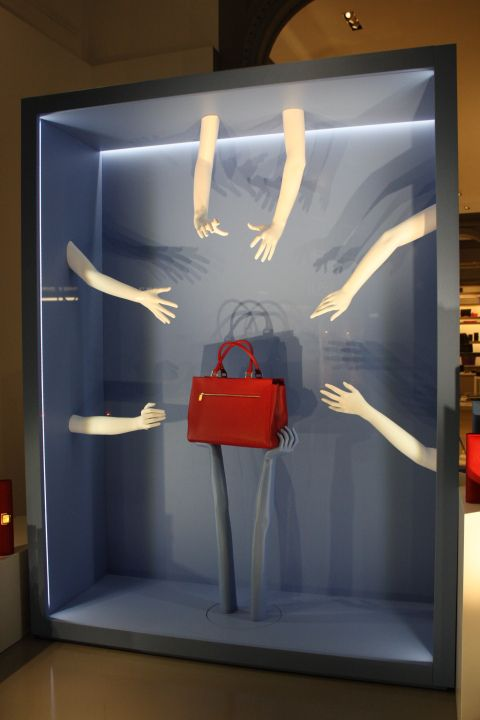 Smythson: Hands off, it's mine!  Love the idea of the hands grabbing it, telling the costumer that you better get your hands on them quick cause they're going fast.