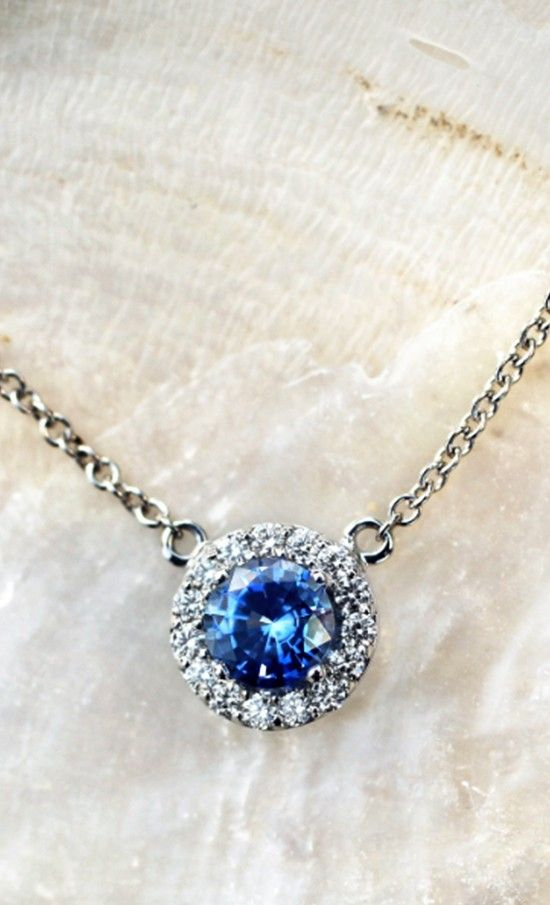 This elegant pendant has a 5mm blue center sapphire surrounded by sparkling pavé-set diamond accents.