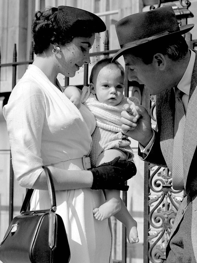 Elizabeth Taylor and Michael Wilding with baby Michael Wilding Jr. in London, 1953.