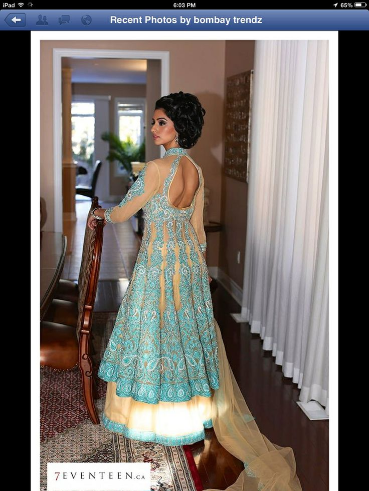 Fascinating long dress in light gold and blue.