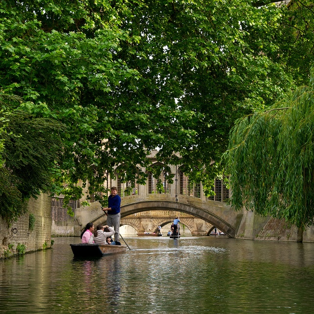 Cambridge. England. Punting on the Cam  River with the the  Cambridge University bridges in the background.