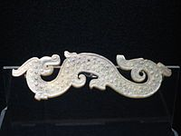 Warring States period - A jade-carved dragon garment ornament from the Warring States period.