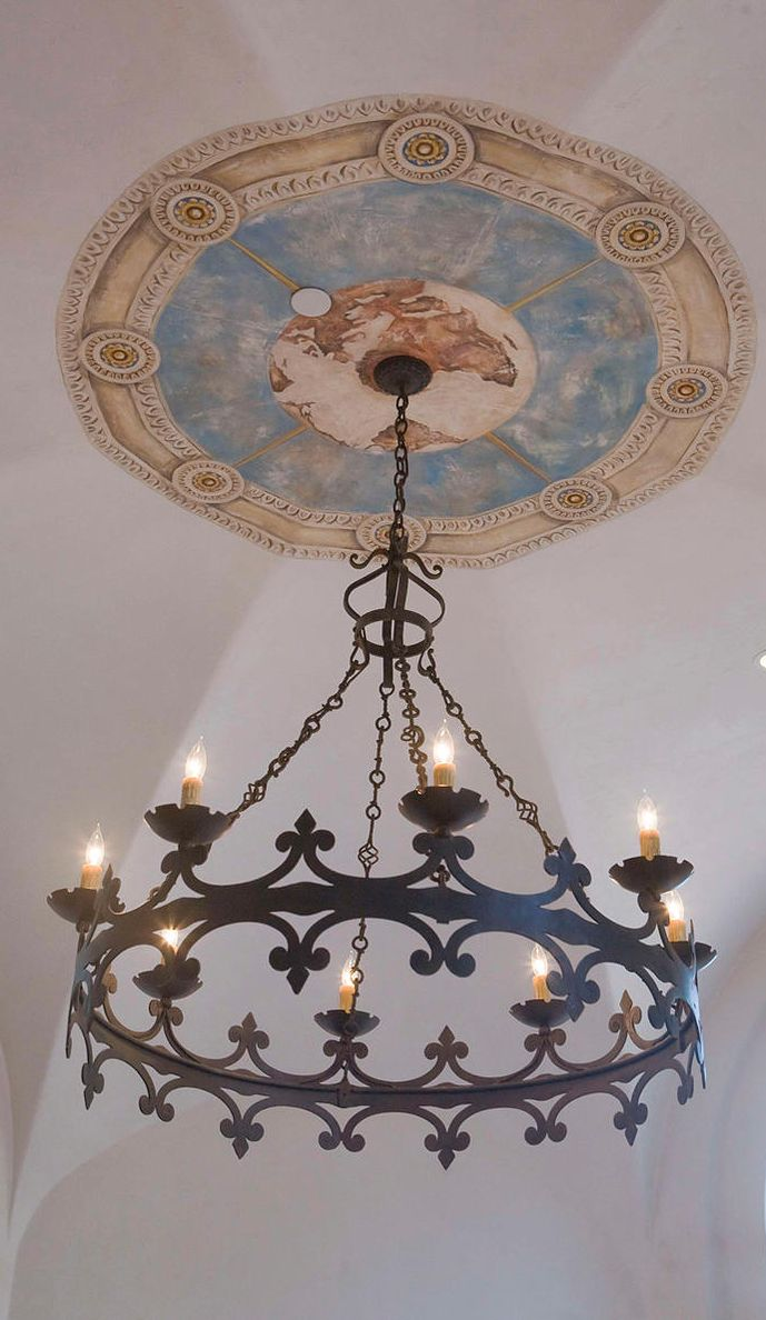 iron chandelier & faux ceiling