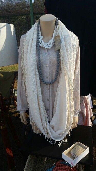 Beautifull knitted batwing top, paired with cream knitted scarf with beautifull details on the edge. Gorgeous grey wooden beads necklace...by Magrietjies.