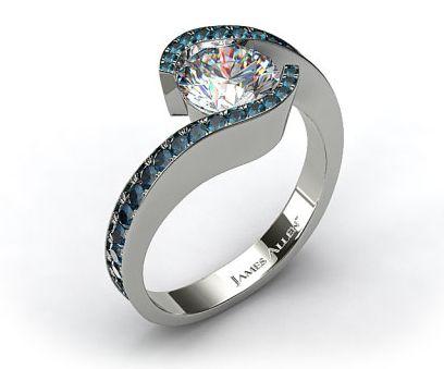Elegant tension set engagement ring with pave diamonds circling around the center diamond.