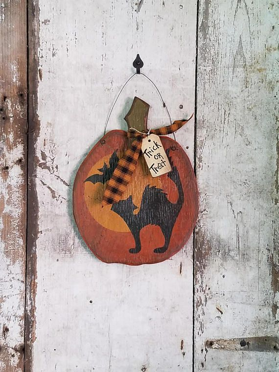 SIZE: 10X 10 - Plywood Primitve / Rustic Halloween Decor - Cat and Bats This pumpkin is cut out of 3/8 plywood. The plywood makes it pretty primitive or rustic in character. The piece is painted with oil base paints and acrylic paints. It is flicked with black paint, scuffed,