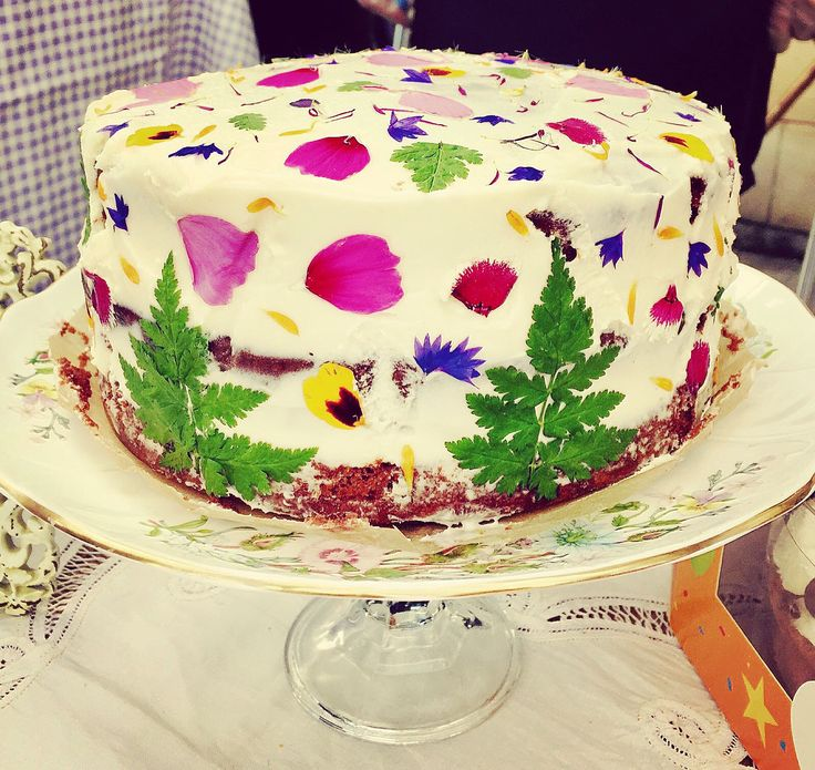 edible flower petal cake with sweet cicely leaves pressed into cream cheese frosting