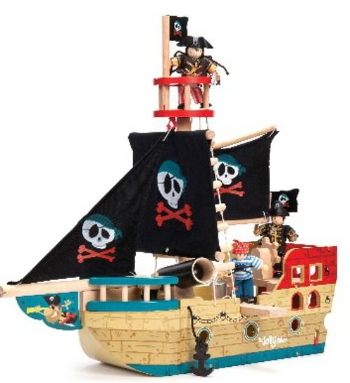 A jolly painted wooden pirate ship featuring a skull and cross-bones motif and fabric sails.   Play features include: a crow's nest, rigging, a turning helm, a 'walk -the-plank', a deck trap-door, a wind-up anchor, a rear-opening stern and a cannon.