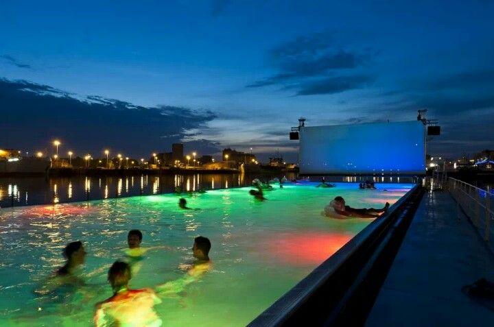 Swimming at night. De Badboot van Antwerpen. World's largest floating open air swimming pool - Antwerp.
