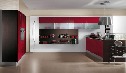 Trendy and sophisticated kitchen | The layout includes flap-door wall units, melamine wall claddings with frosted glass  shelves, and tall and larder units with access gaps, which also contain the oven.