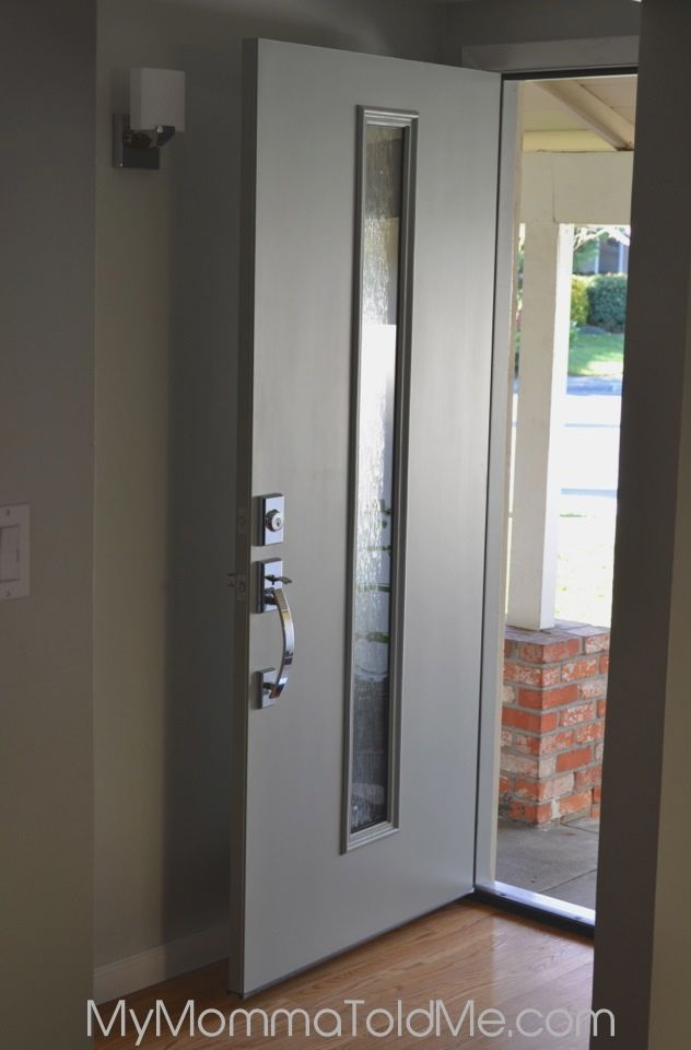 New modern front door installed! Mid-century modern front door with glass inset, chrome door handle! Check out the before and after pics!