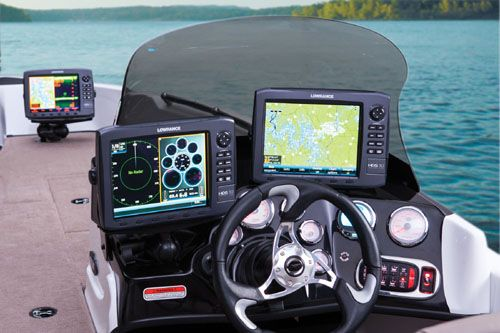 "Nitro ZV 21: The helm console is larger than it might appear as this picture demonstrates with these two huge screens. A Lowrance sonar/chartplotter comes standard with a 6.4"" screen. Note the wheel, which is the sportiest one we have ever seen on a multi-species boat."