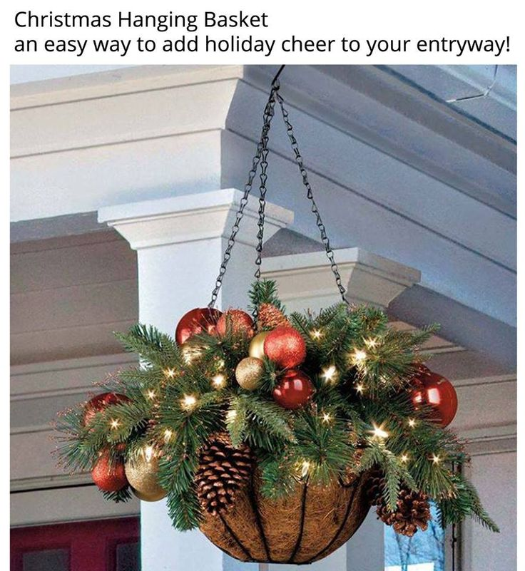 This would be great hanging from shepherd's hooks at our front door.   A couple of sets of white lites, basket fillers of greens, perhaps a wet foam block inside ?   Outdoor shatter proof ornaments, pine cones wired in, and voila !