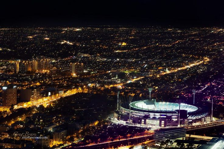 Aerial night view of the city and Melbourne Cricket Ground - home of Australian Football and the National Sprots Museum