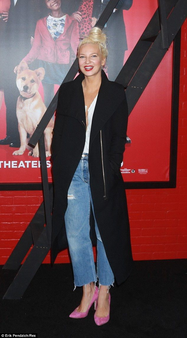 Rare look: Sia Furler stepped out at the film premiere of Annie in New York on Sunday with face uncovered
