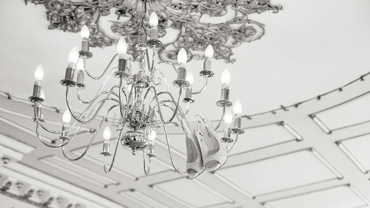 Benjamin Adams Shoes hanging from the chandelier in the Rococco suite at Gosfield Hall Wedding | Photography by Enchantingwood.  http://www.enchantingwood.co.uk/gosfield-hall-wedding-photographer/