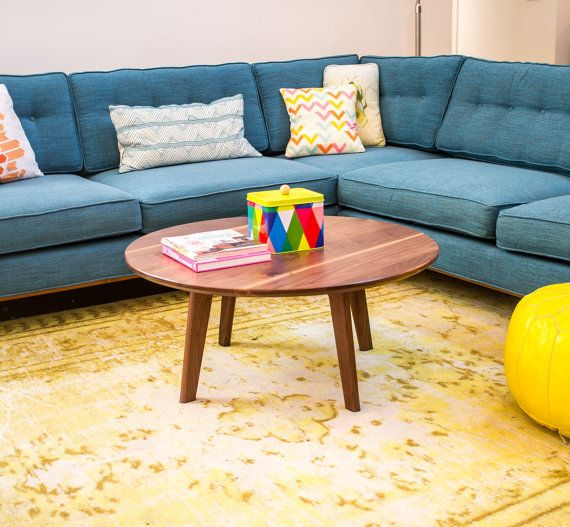 Love the idea of a low, blue sectional with yellow accents. // The Mila: Mid Century Inspired Solid Walnut Round Coffee Table