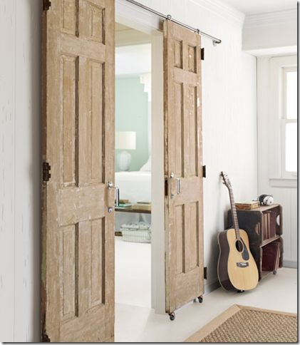 DIY sliding door for the family room.  We have old doors from the Blunt house.