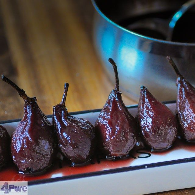 Pears au vin rouge a recipe for classic poached pears in red wine.