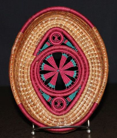 """This stunning pine needle basket is 8.5"""" x 6.75"""".  It has 3 teneriffe center pieces accented with fuschia and teal stitching."""