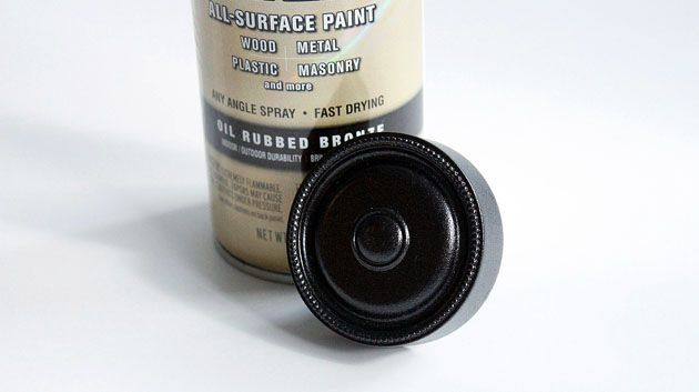 How to Paint Door Hardware    Materials:  Grease Cleaner (kitchen countertop spray works fine)  Rag  Steel Wool  Painter's Tape  Can of Automotive or Metal Spray Primer  Can of Oil Rubbed Bronze (or whatever color you want) Spray paint  Plastic Sheet (old shower curtain, tarp or plastic table cloth)  Optional: Spray Paint Handle (keeps fingers clean and from cramping)