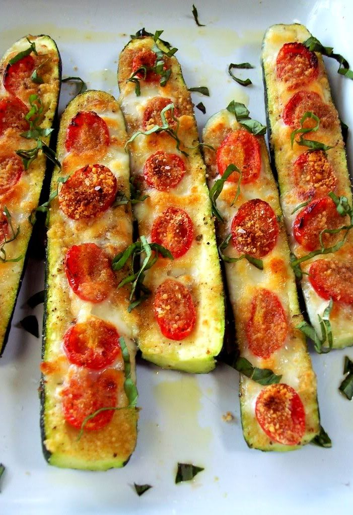 Veggie Zucchini Pizza Boats from Proud Italian Cook! I love making these with different toppings! If you haven't tried them, you need to!!