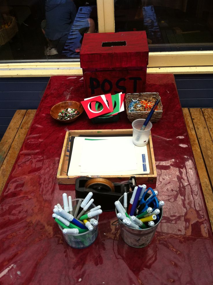 Making letters for Santa using recyclable materials.