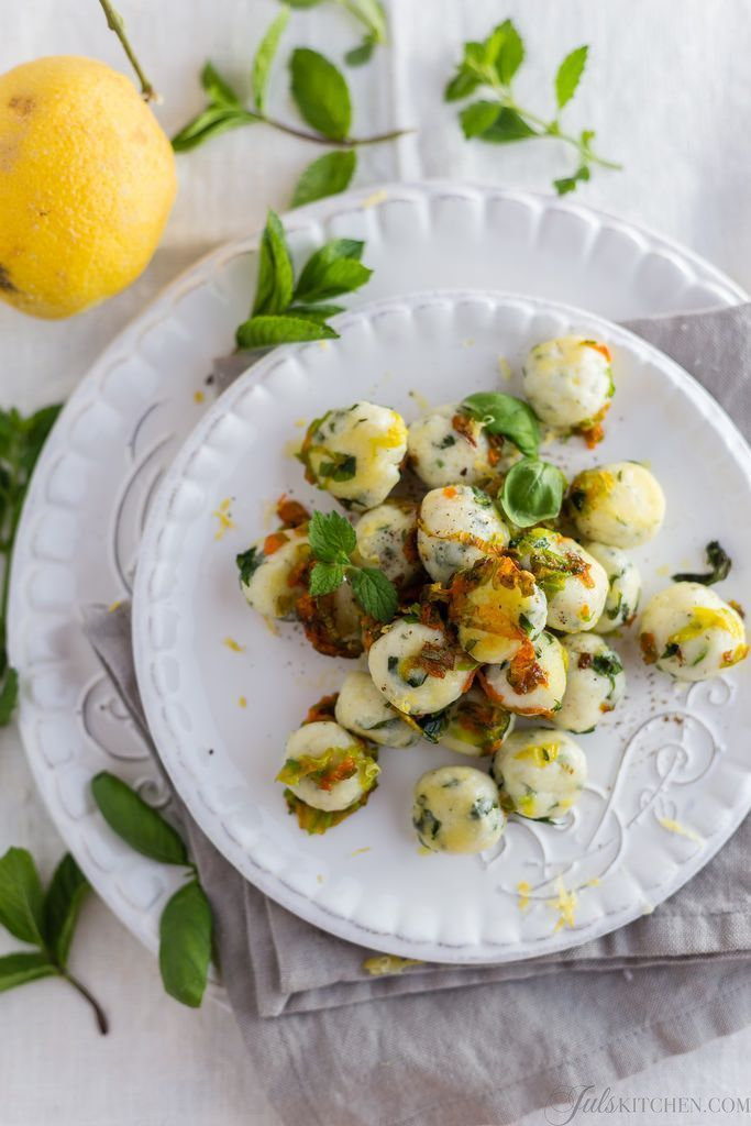 Italian ricotta gnocchi with fresh herbs and zucchini blossoms. A light and refreshing #summer dish.