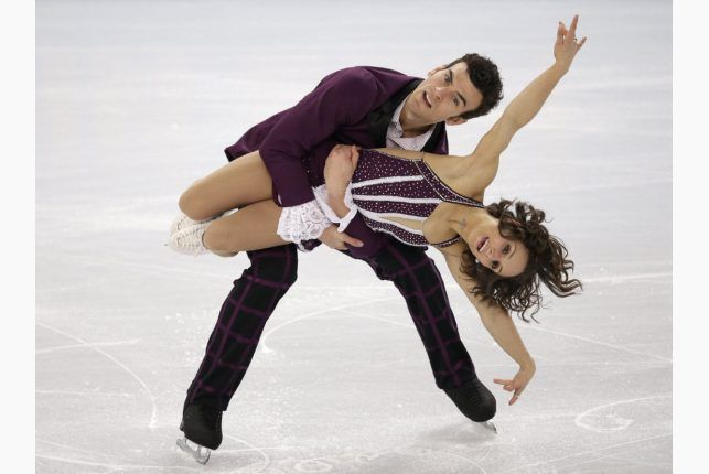 Canada's Meagan Duhamel and Eric Radford compete in the pairs free skate figure skating competition at the Sochi Games. The pair placed seventh overall. (Feb. 12, 2014) AP photo