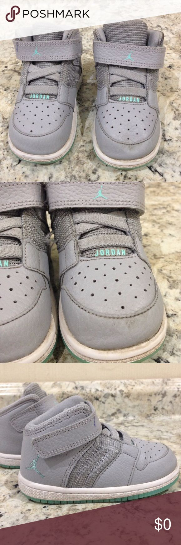 🌴NEW LISTING🌴 Jordan Sneakers Gray. Shows sign of wear.  Small Ink mark on Velcro band (see pic 5). Net has a rubbing (see pic 6). Rubber is soiled. Size 7C. (4/6) Jordan Shoes Sneakers