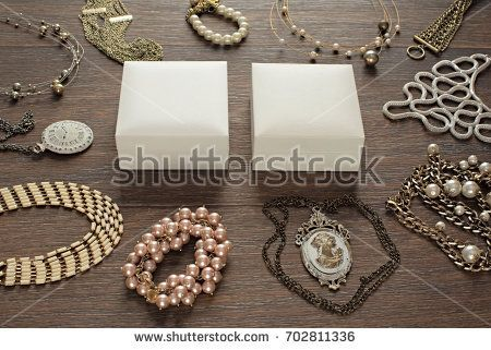 Vintage composition lay flat jewelry for women and gift packaging. The view from the top. Wooden dark background