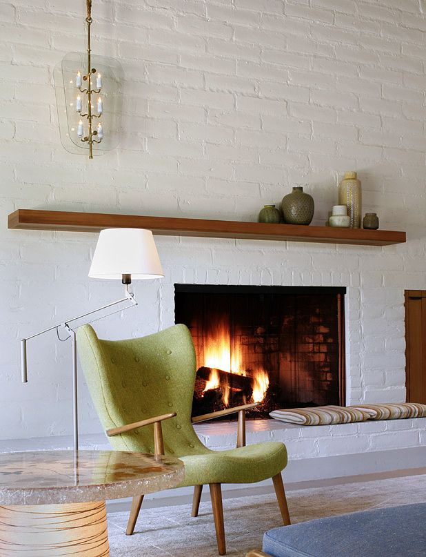via Home Adore, designed by Charles DeLisle. Love that chair. And ceramics colors on the mantel.