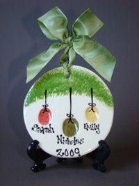 Thumbprint Ornaments...easy to do yourself! Wonder if we can fit all four kids' for grandparents gift