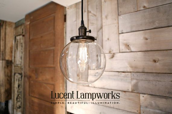 This beautiful simple globe is perfect in so many decor themes.  Available in many finishes and wire styles.  US Made! https://www.etsy.com/listing/79935698/hanging-pendant-light-fixture-with-8? Hanging Pendant Light Fixture with 8 Glass Globe Shade and Exposed
