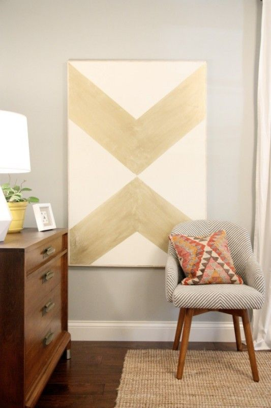 large geometric graphic art over an existing painting. DIY wall art.