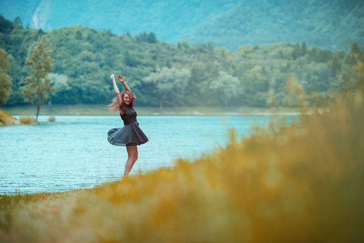 Dancing on the grass. - A shot taken on Lake Tenno with a friend dancing on the grass, Trentino alto Adige, Italy,  Instagram: @mattiabonavida www.mattiabonavida.it