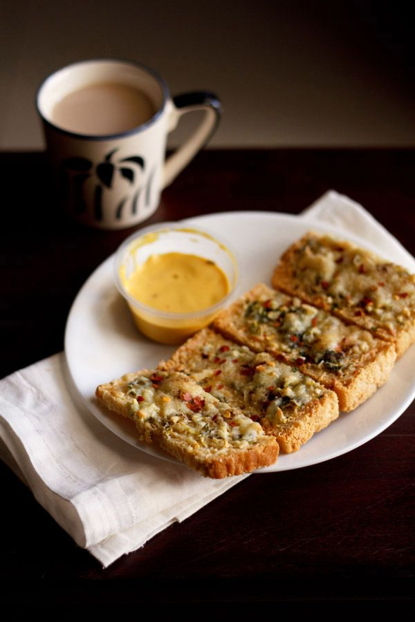 cheese garlic toast recipe with step by step photos. quick breakfast recipe for the busy morning hours. also shared cheese chilli toast recipe.