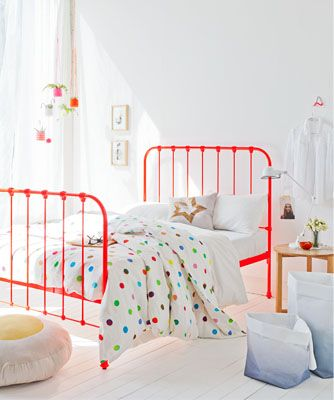 Kid's room with a smattering of color popping pieces for a fresh and simply space!