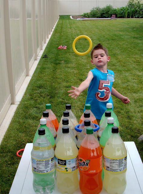 Kids Playing Soda Bottle Ring Toss Game