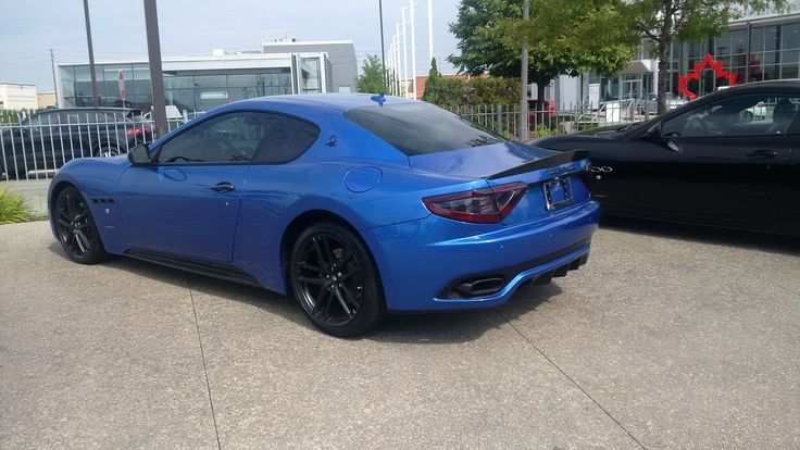 Blue Maserati with carbon rear fin