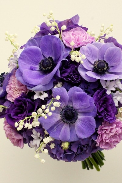 purple bouquet: anemone, lisianthus, hydrangea, hyacinth blooms, carnations and white lily of the valley. Love the anemone...