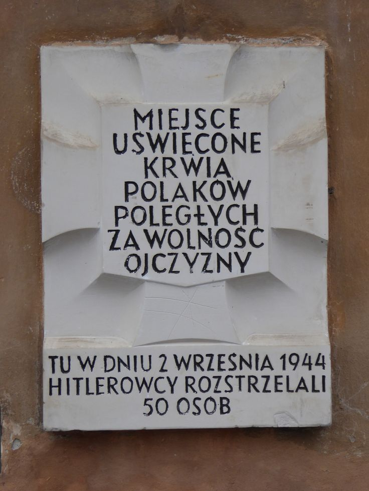 """A """"Tchorek plaque"""" in Royal Castle Square (Plac Zamkowy). The Germans executed 50 people here on 2nd September 1944, during the Warsaw Uprising...."""