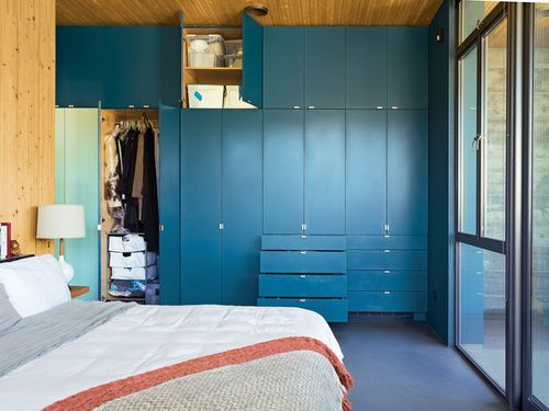 Sleek colorful storage runs from the bedroom dressers for Declutter bedroom ideas